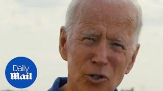 'She pulled ME close!' Biden jokes about his touchiness at NH rally