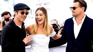 Margot Robbie jokes with Leo DiCaprio and Brad Pitt at photocall